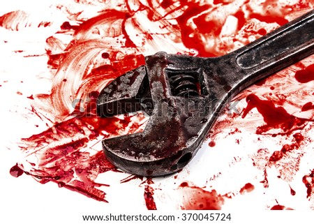 Wrench in blood on white background