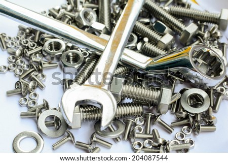 Wrench, nuts and bolts - stock photo