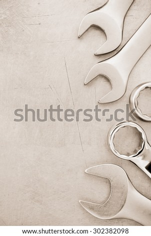 wrench tools at metal background - stock photo
