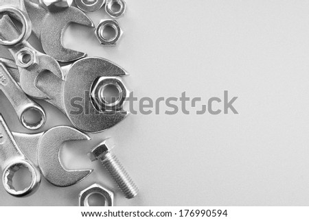Wrench tools on metal background. Empty space for Your text