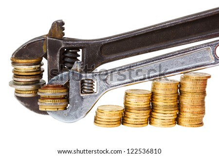 wrenchs and coins on white background - stock photo