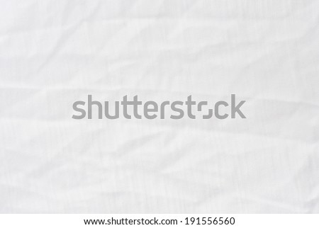 Wrinkle white cotton polyester fabric texture, detailed closeup, rustic crumpled vintage fabric.