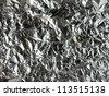 wrinkled aluminium foil background texture - stock photo