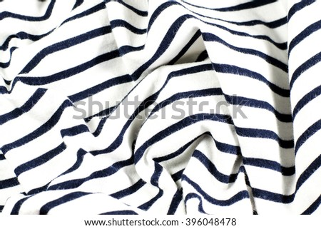 wrinkled black and white striped fabric as background - stock photo