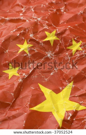 wrinkled chinese paper flag, vertical detail photo - stock photo
