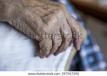 wrinkled hand - stock photo