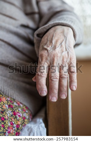 wrinkled hand of a senior person - stock photo