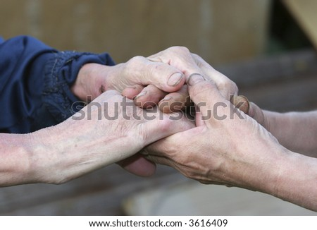 wrinkled hands meeting together