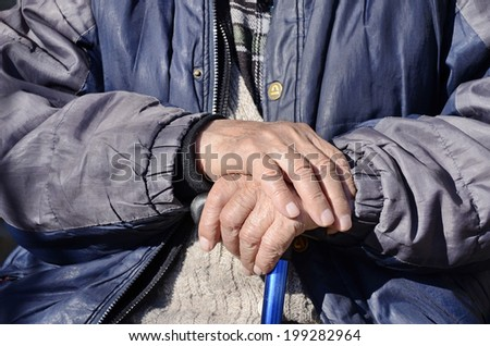 Wrinkled hands of an old men     aging process - stock photo