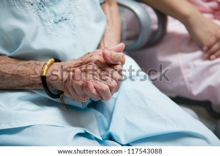wrinkled hands  of old woman.