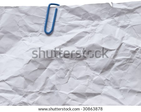 Wrinkled paper with blue paper clip - stock photo