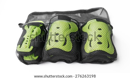 Wrist guard, knee guard and elbow guard protector for skateboarding. Isolated on white background. - stock photo