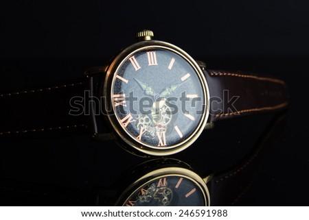 Wristwatch on black background - stock photo