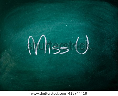 "write a chalk ""Miss U"" on a black board - stock photo"