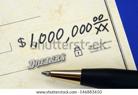 Write a check of one million dollars concept of wealth - stock photo