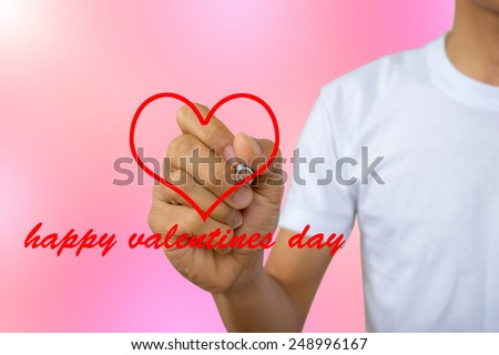 write happy valentines day - portrait of men in white vest writing in the air