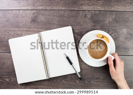 Writer and artist hand coffee break. minimalistic composition. Top view. empty white space you can put your text