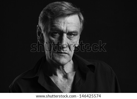 Writer. Dramatic portrait. Black background