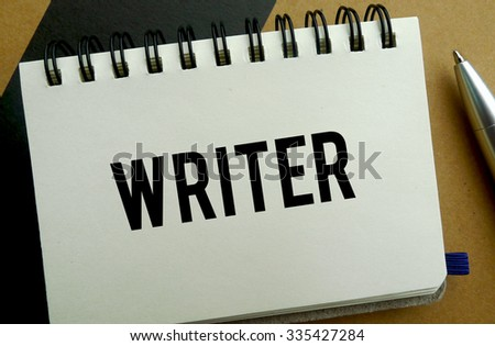 Writer memo written on a notebook with pen - stock photo