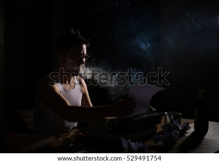 Writer novelist working on a book using typewriter