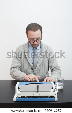 Writer typing on an old typewriter in the office