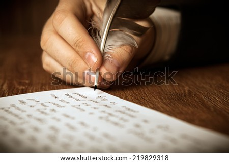 writer writes a fountain pen on paper work close up - stock photo