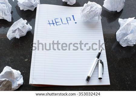 Writers Block. Help!. Writing. Paper lump. Marble background. - stock photo