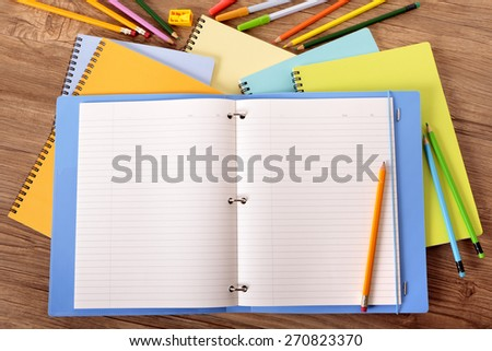 Writing book open on student desk, pencil, copy space - stock photo