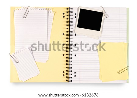 Writing book or scrapbook with various untidy attachments including note paper, sticky notes and blank instant camera photo prints prints isolated on a white background.  Space for copy. - stock photo