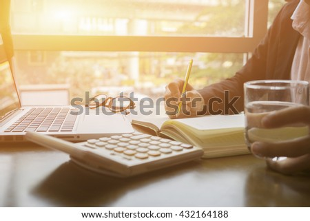 Writing,Businessperson Signing Contract,Man writing paper at the desk, man writing with pen,register a marriage,divorce,man Signing,Contract, Form in office ,vintage color ,selective focus.copy space  - stock photo