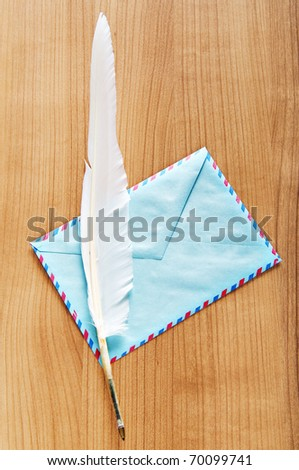 Writing feather and envelope