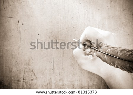 writing hand with pen feather on sepia - stock photo