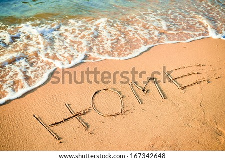 Writing Home on the Beach in Thailand - stock photo