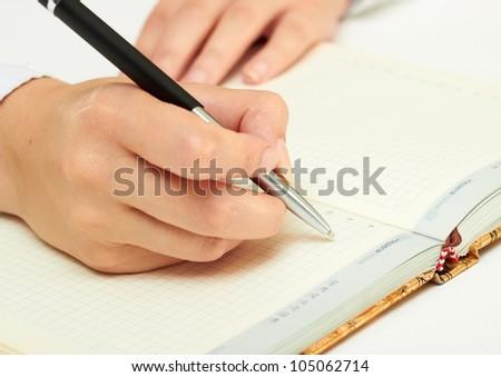 writing in diary - stock photo