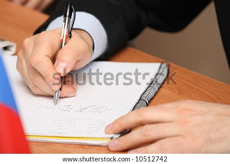 Writing in notepad - stock photo