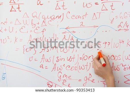writing on the whiteboard formulas, closeup - stock photo