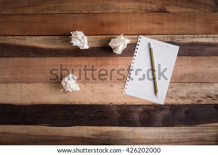 writing paper scarp of paper and pencil on wooden table - stock photo