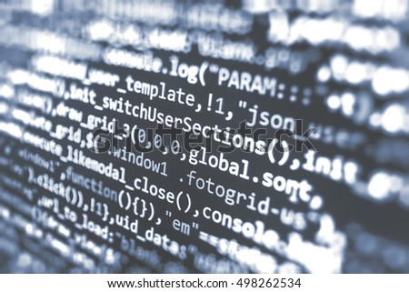 Writing programming code on laptop. Website codes on computer monitor. Abstract source code background. IT specialist workplace. Web site codes on computer monitor. Computer script typing work.