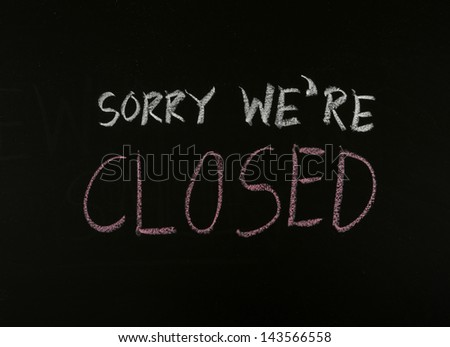 writing sorry we are closed on blackboard - stock photo