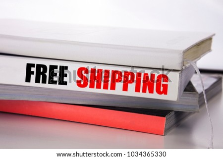 Writing text showing Free Shipping. Business concept for Delivery For Transport written on the book the white background.