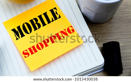 Writing text showing Mobile Shopping. Business concept for Cellphone online order written sticky note paper, Wooden background with copy space, Coffee and marker