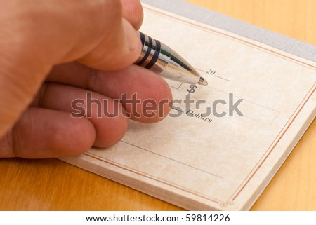 Writing The Domination on Check - stock photo