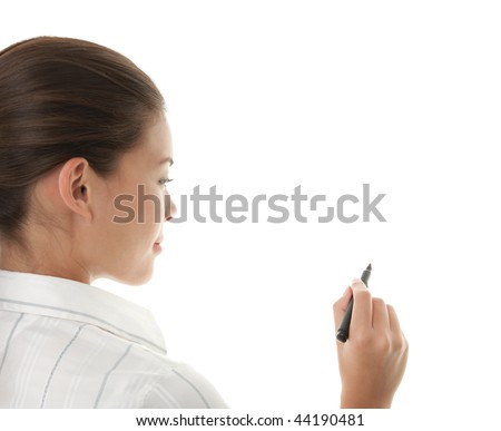 Writing with pen. Young beautiful businesswoman with pen writing on whiteboard. Focus on black marker. Lot's of copy space. Mixed race chinese / caucasian model isolated on seamless white background. - stock photo