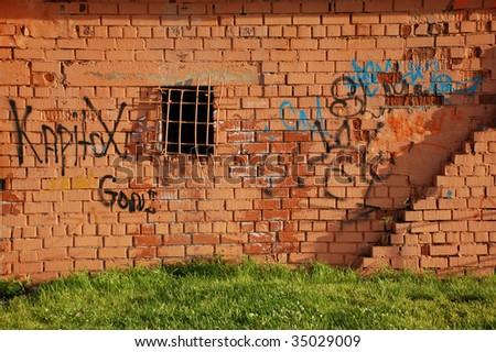 Writings On A Wall, Window With Bars - stock photo