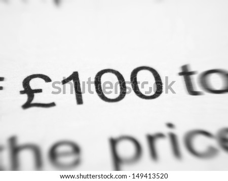 Written contract closeup with 100 GBP.
