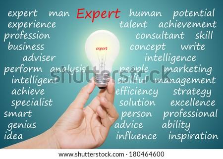 Written expert in the light bulb  - stock photo