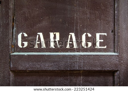 Written in a garage wooden door in San Gimignano in Tuscany - stock photo