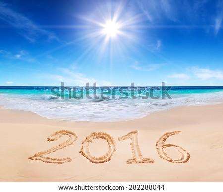 written 2016 on the beach - stock photo