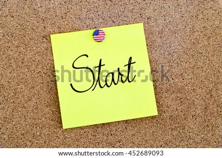Written text Start over yellow paper note pinned on cork board
