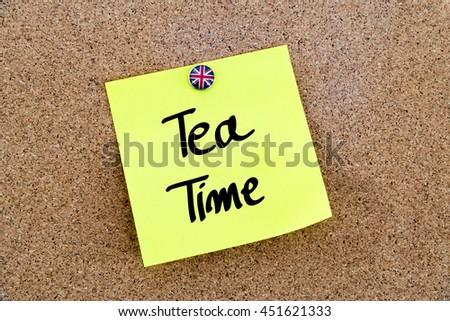 Written text Tea Time over yellow paper note pinned on cork board